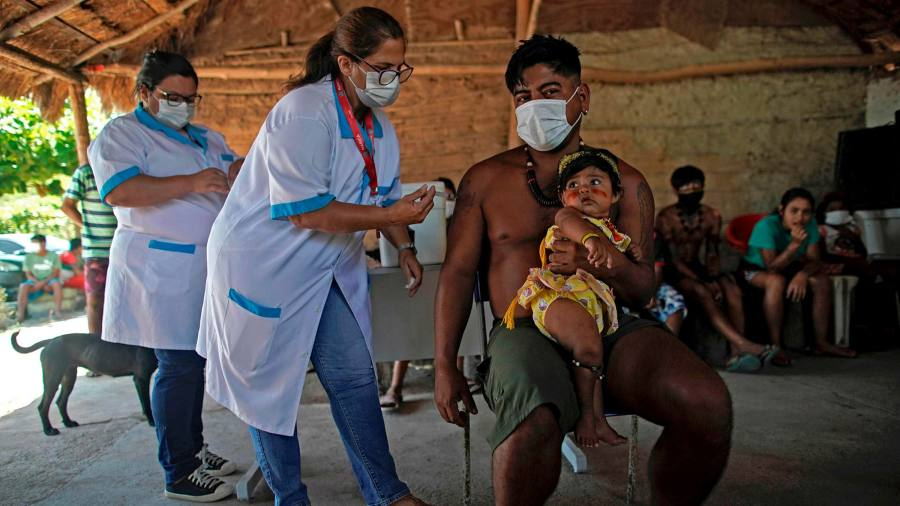 Brazil's vaccination hindered by bottlenecks and a sceptical leader